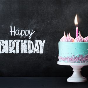 Birthday cupcake in front of a chalkboard