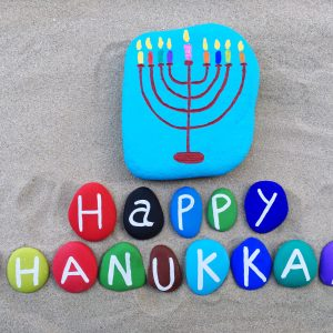 happy-hanukkah-composed-with-colored-stone-letters-37NJ3NQ