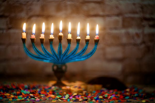 Brightly Glowing Hanukkah Menorah soft focus