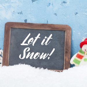 Christmas eCard with a small snowman and a chalkboard that says Let It Snow