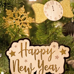 Happy New Year Card with ornaments in a tree